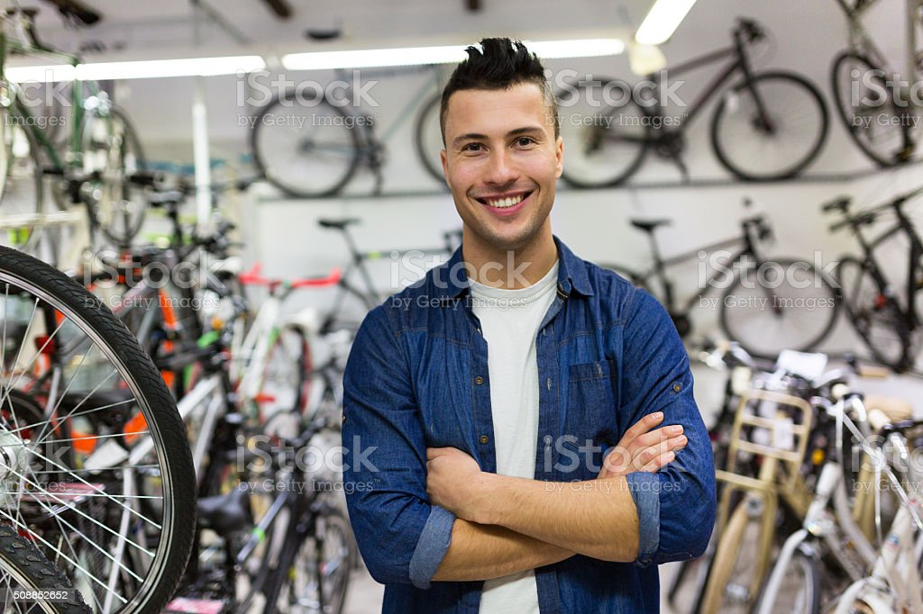 Salesman in bicycle shop stock photo