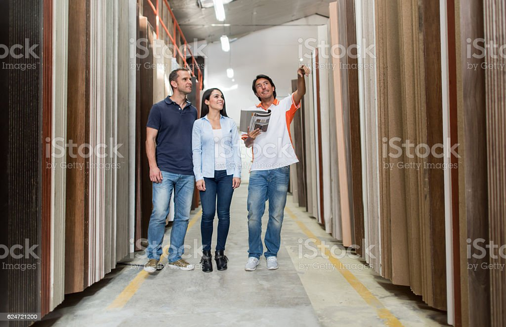 Salesman making a sale at a flooring store stock photo
