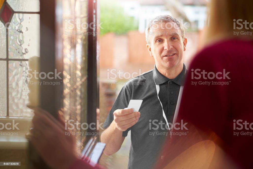 salesman making house call stock photo