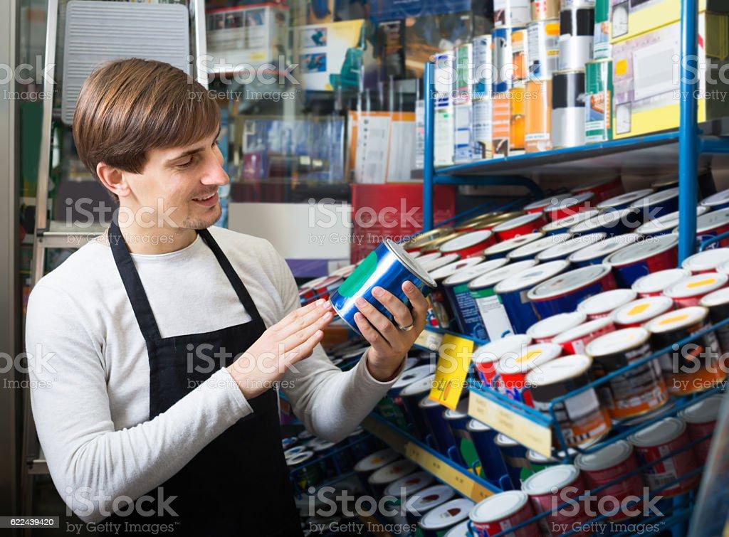 Salesman offering enamel in store stock photo