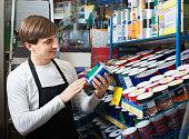 Salesman offering enamel in store
