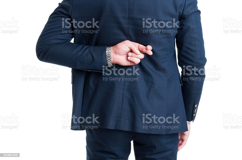 Salesman or businessman making fingers crossed good luck gesture stock photo