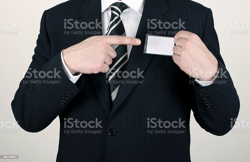 Salesman pointing out his nametag royalty-free stock photo