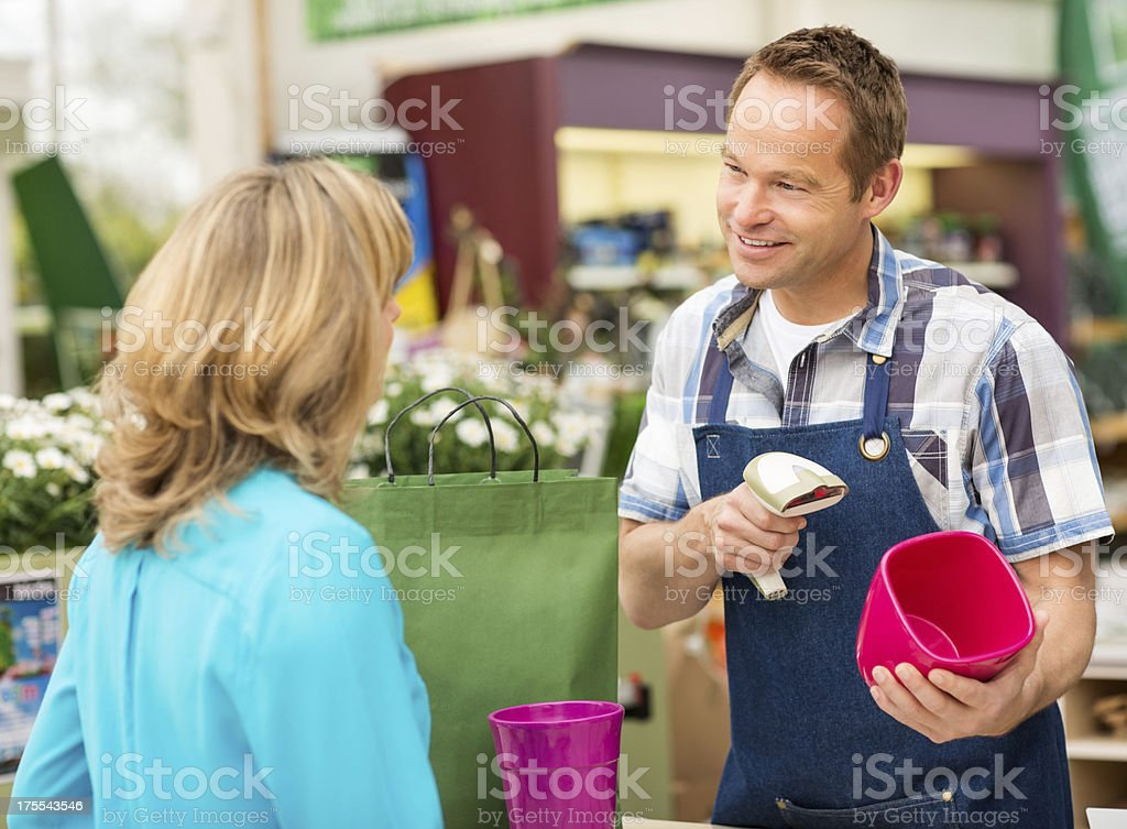 Salesman Scanning Merchandise For Checkout royalty-free stock photo