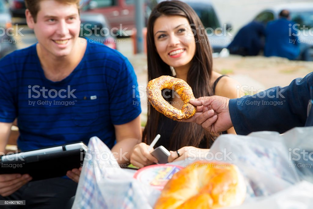 Salesman selling simit in Istanbul stock photo