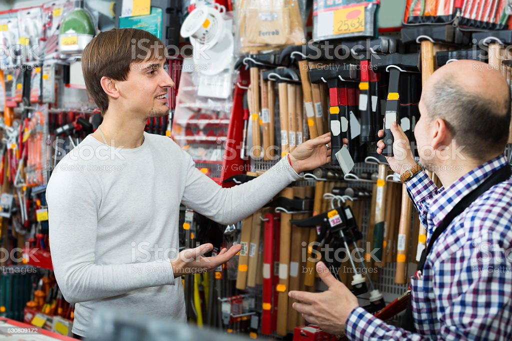 salesman showing different tools stock photo