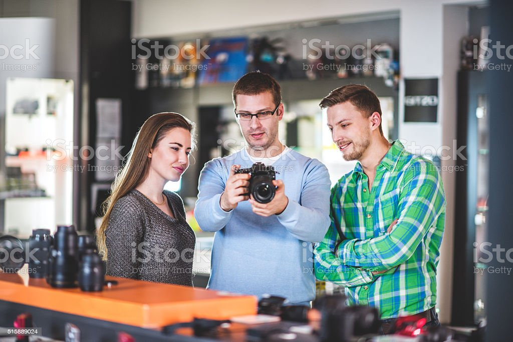 Salesman showing digital camera stock photo