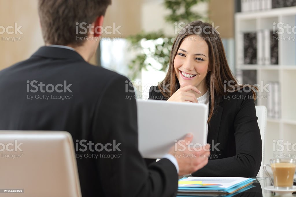 Salesman showing product to a client stock photo