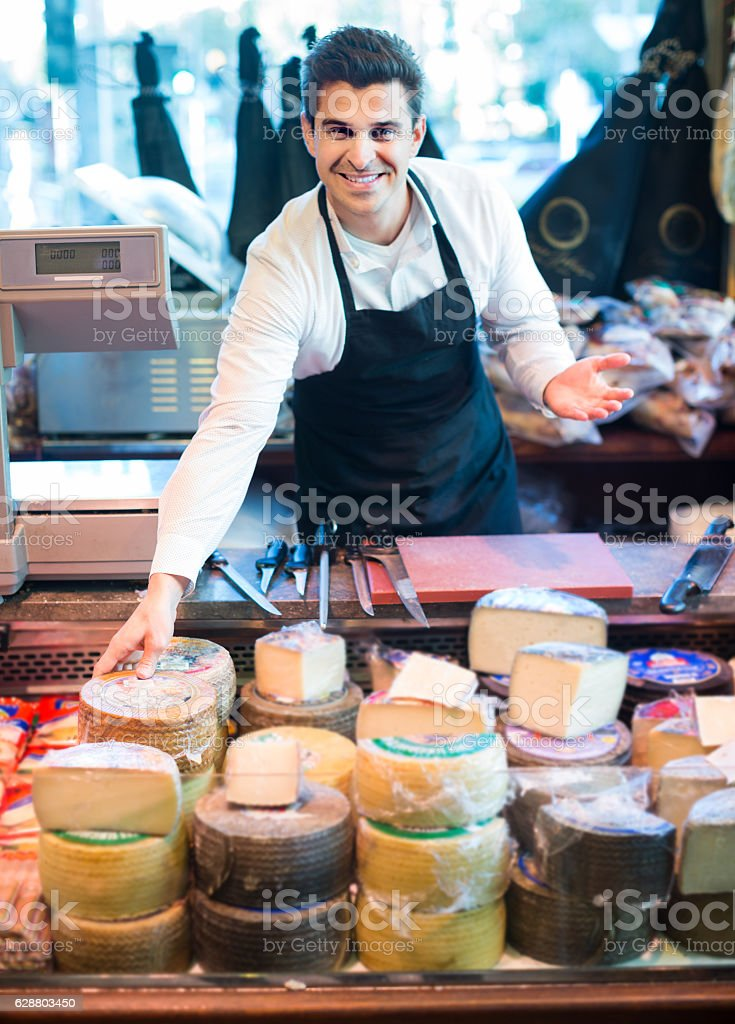 salesman with cheese in gastronomy stock photo