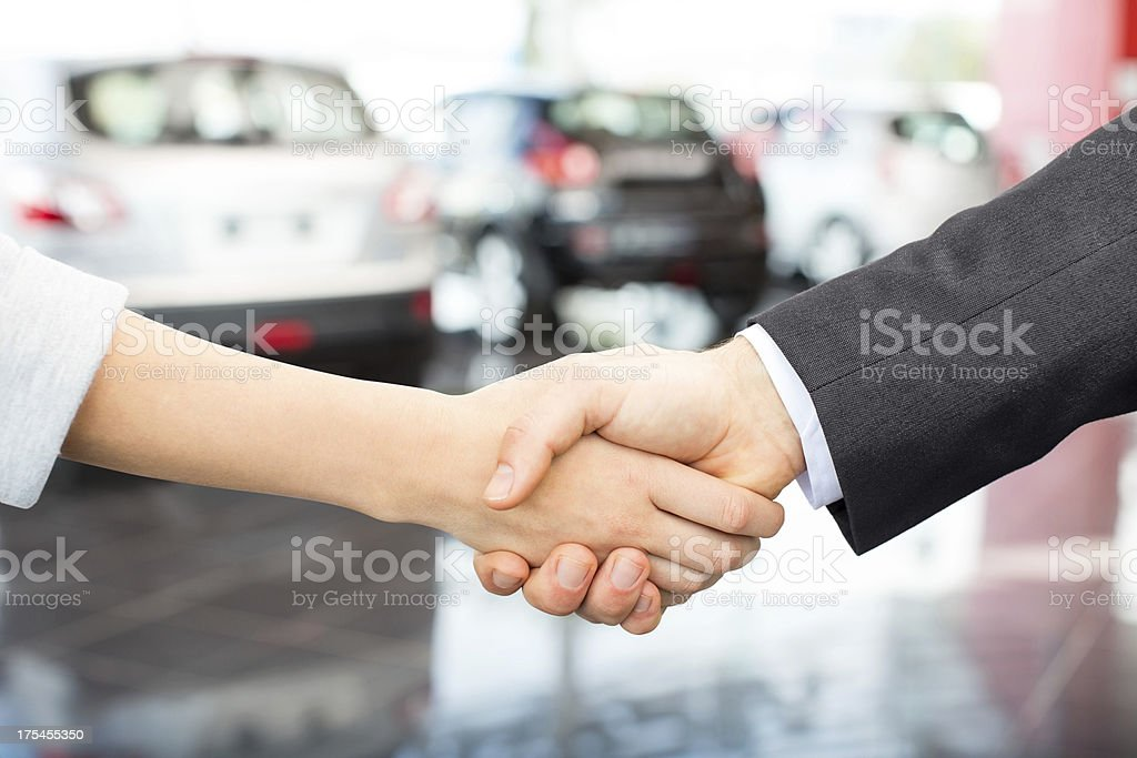 Salesperson Shaking Hands With Female Customer stock photo