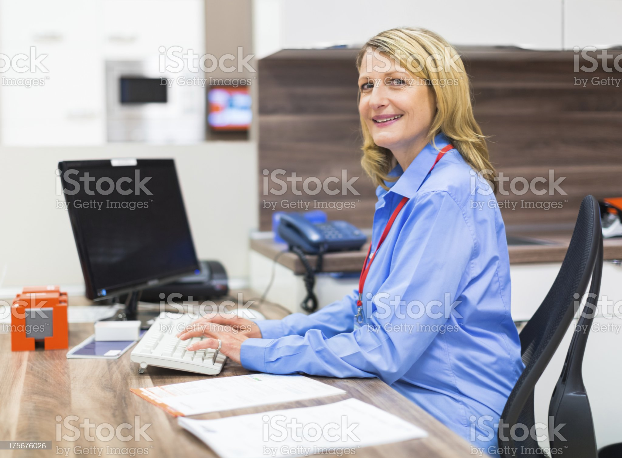 Saleswoman Behind Her Desk royalty-free stock photo