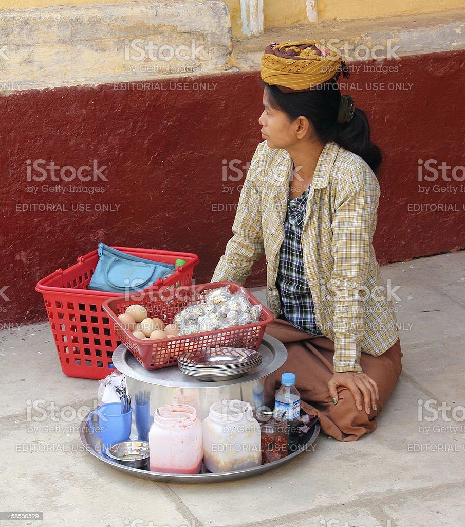 saleswoman in Shwezigon pagoda royalty-free stock photo