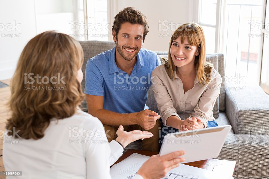 Saleswoman presenting a new project property on digital tablet stock photo