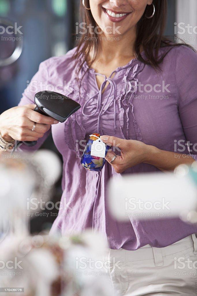Saleswoman scanning merchandise stock photo