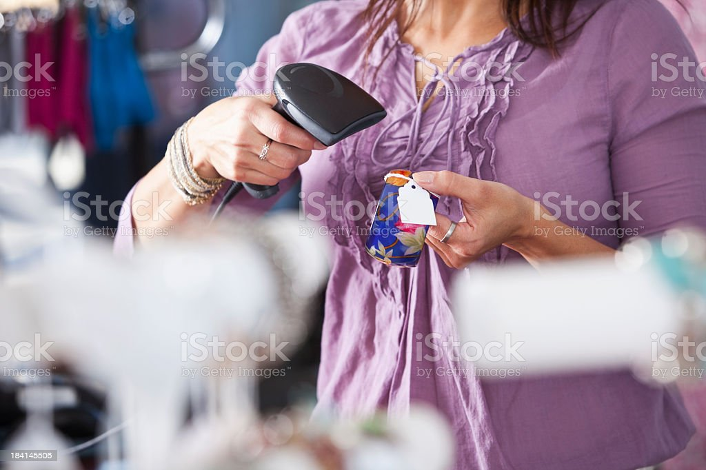 Saleswoman scanning merchandise royalty-free stock photo
