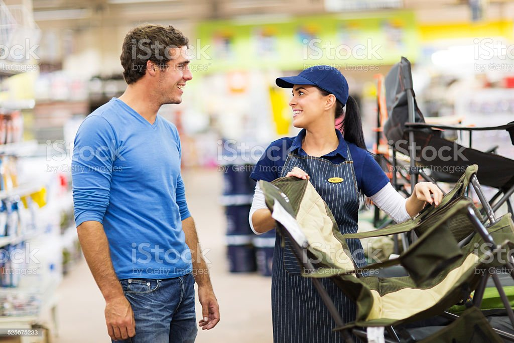 saleswoman selling camping chair stock photo