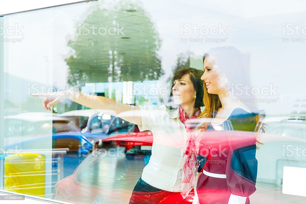 Saleswoman selling car to woman stock photo