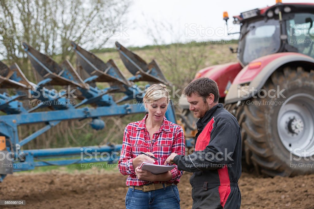 saleswoman try to sell new tractor to farmer stock photo