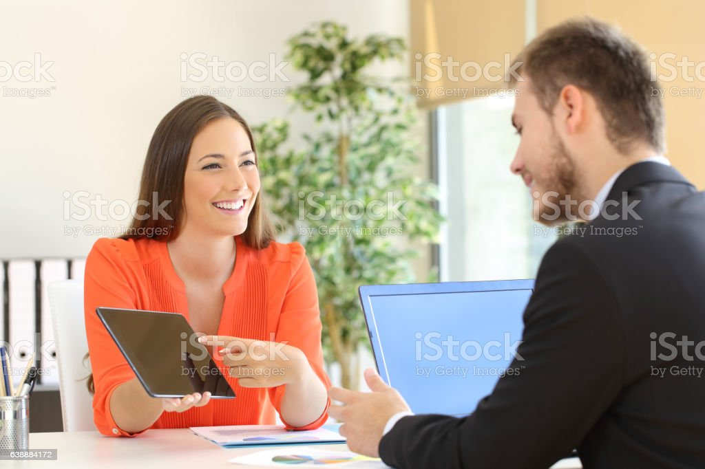 Saleswoman trying to sell to a client stock photo