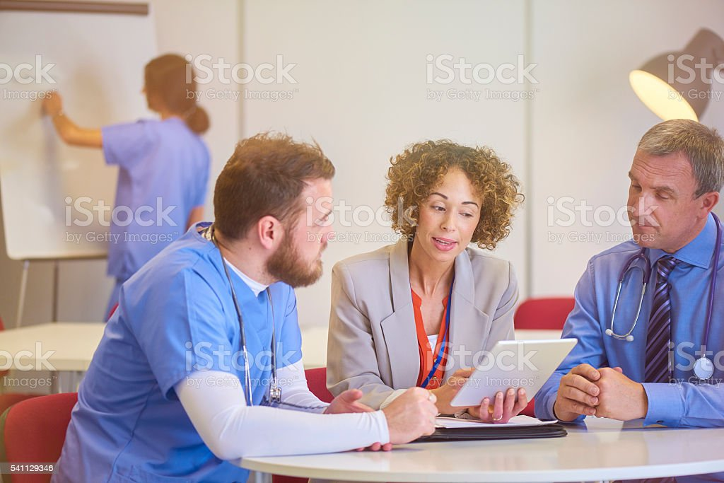 saleswoman with medical staff stock photo