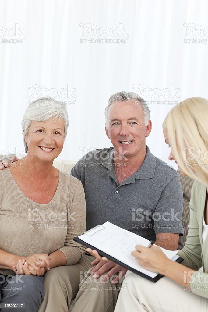 Saleswoman with seniors royalty-free stock photo