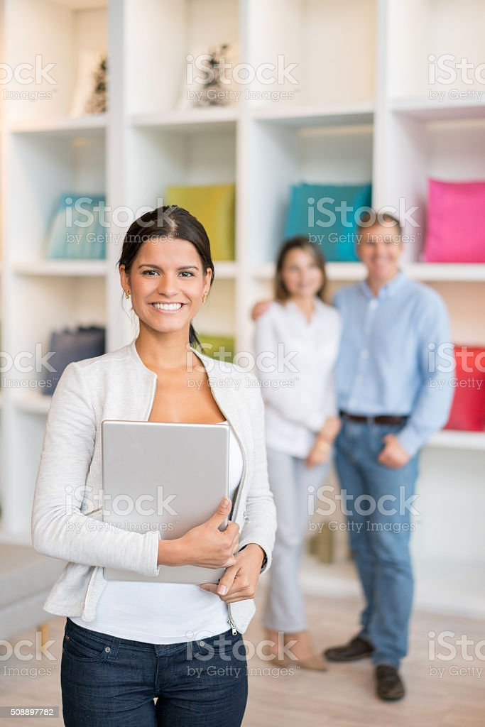 Saleswoman working at a furniture store stock photo