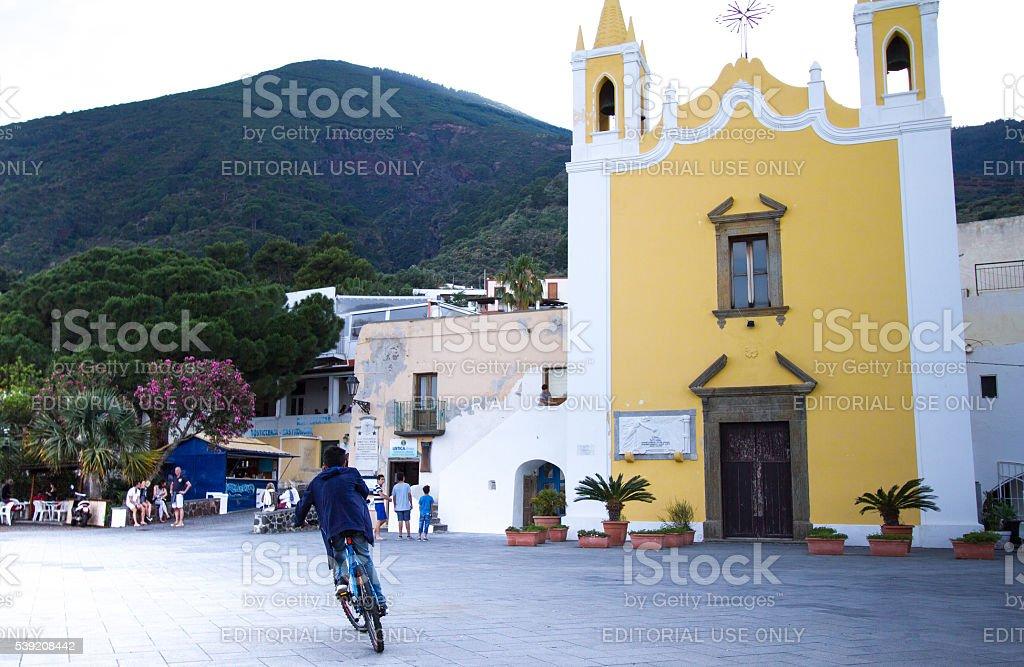 Salina, Sicily: Piazza, People, Yellow Church of Maria Ss Addolorata stock photo