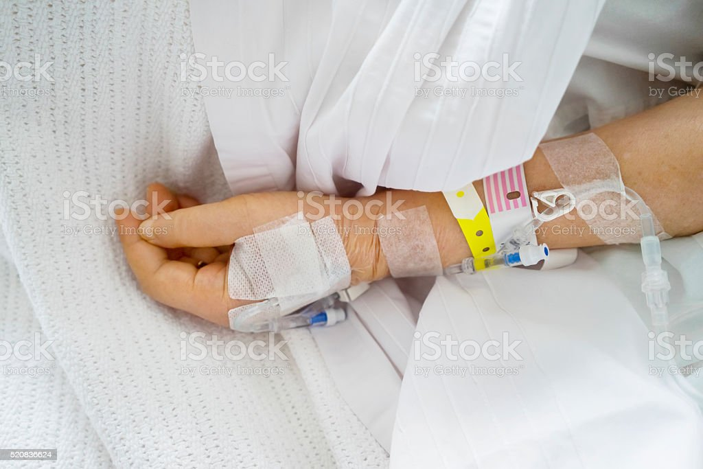 Saline solution in the hand of patient stock photo
