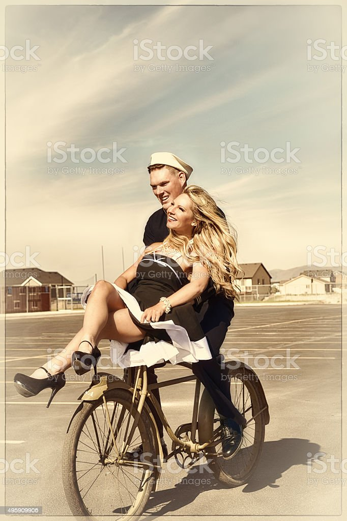 Salior and His Girl On Old Army Bike stock photo