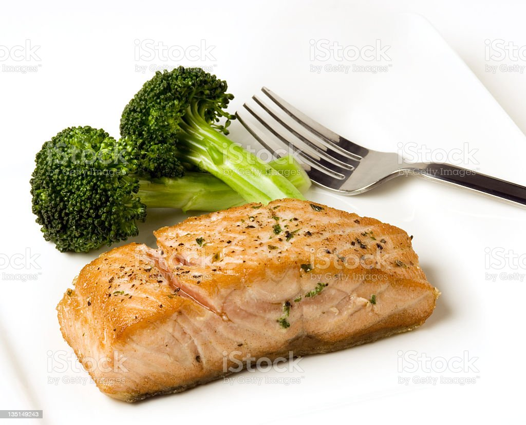 Salmon and brocolli in a white plate royalty-free stock photo