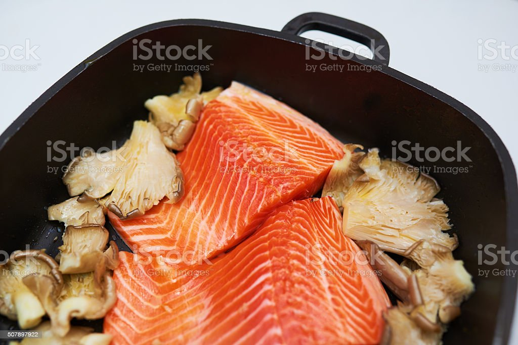salmon and mushrooms in a pot stock photo