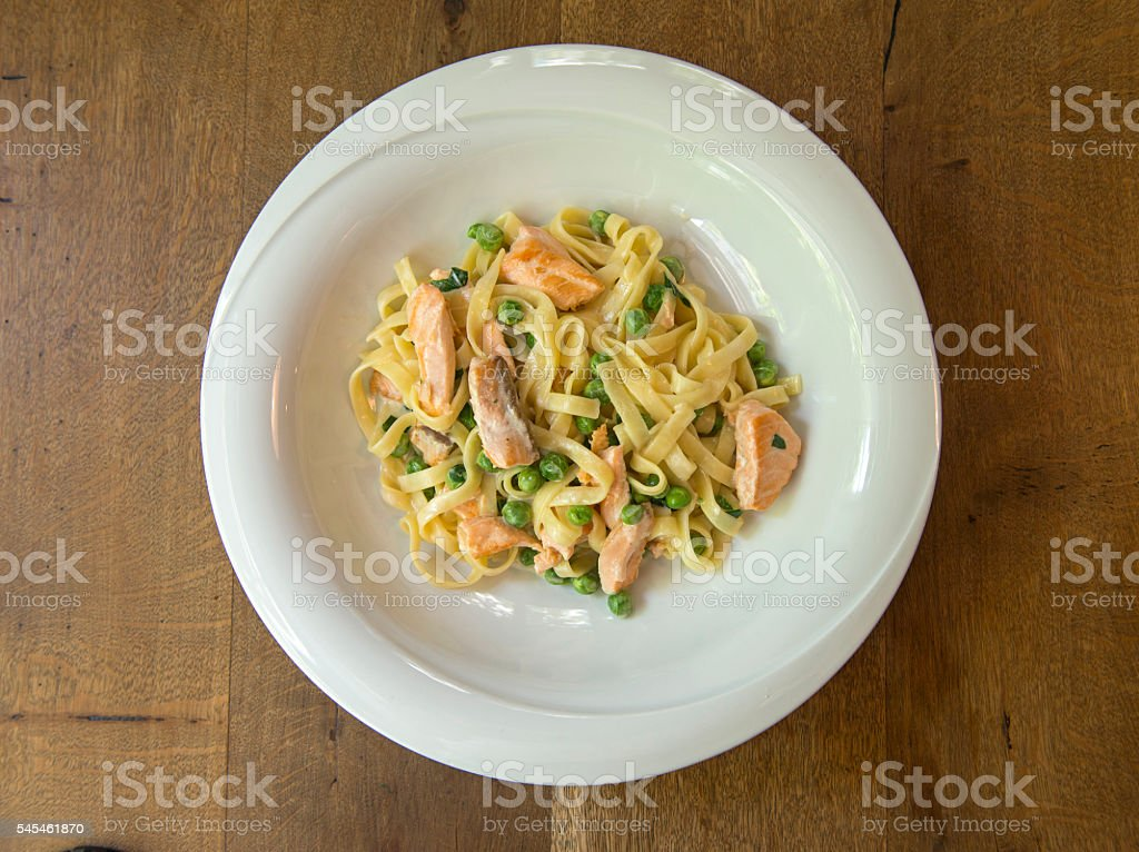 Salmon and pea linguine pasta stock photo