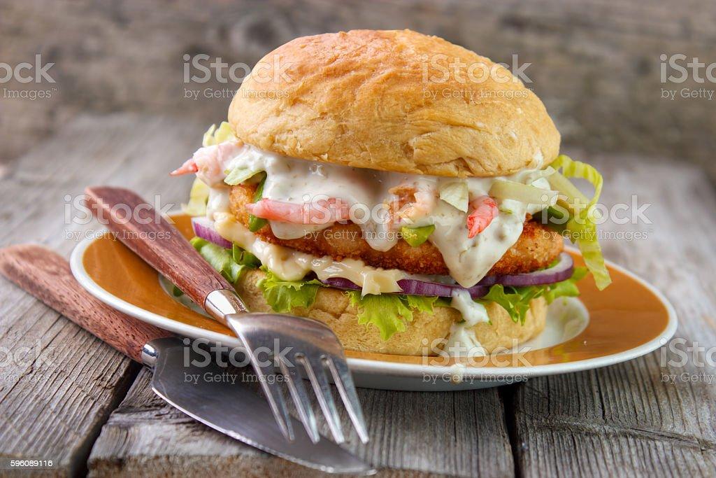 Salmon and shrimp burger stock photo