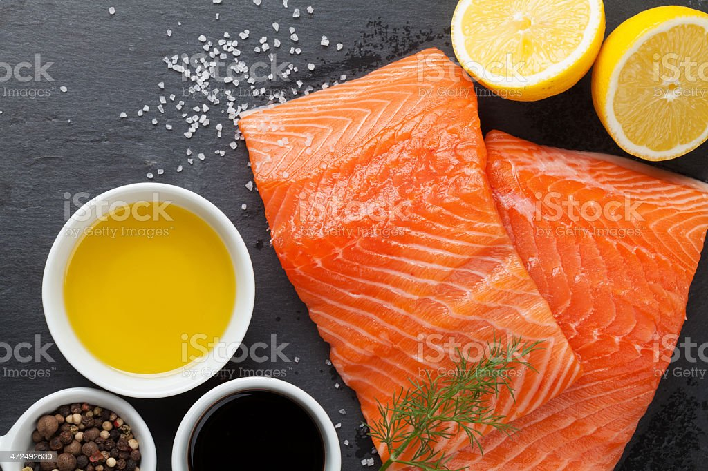 Salmon and spices on stone table stock photo