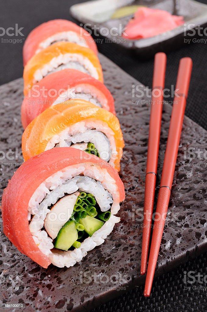 Salmon and tuna sushi roll royalty-free stock photo