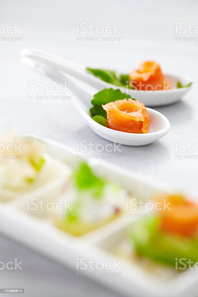 Salmon appetizers on spoon royalty-free stock photo