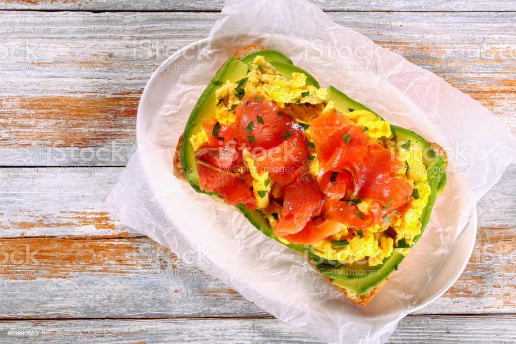 salmon avocado scrambled egg ciabatta sandwich stock photo