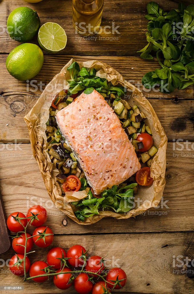 Salmon baked in papillote stock photo