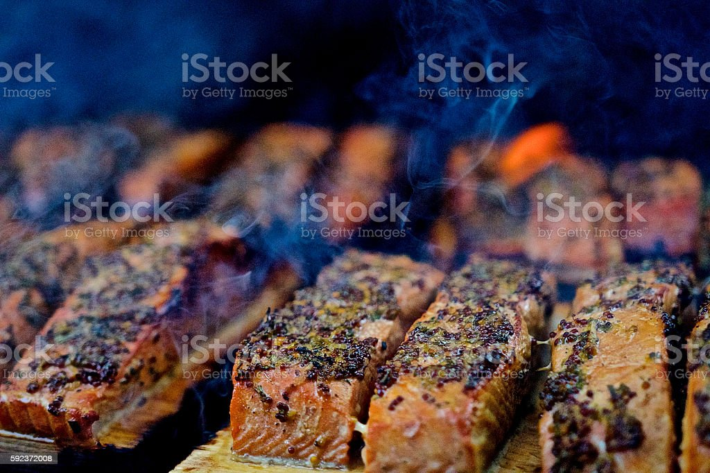 Salmon being smoked on BBQ stock photo