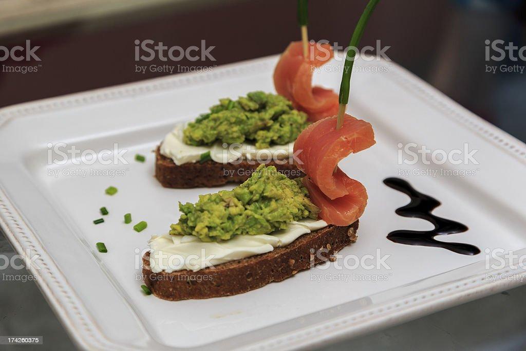 Salmon Boats, Avocado Paste, Homemade Rye Bread stock photo