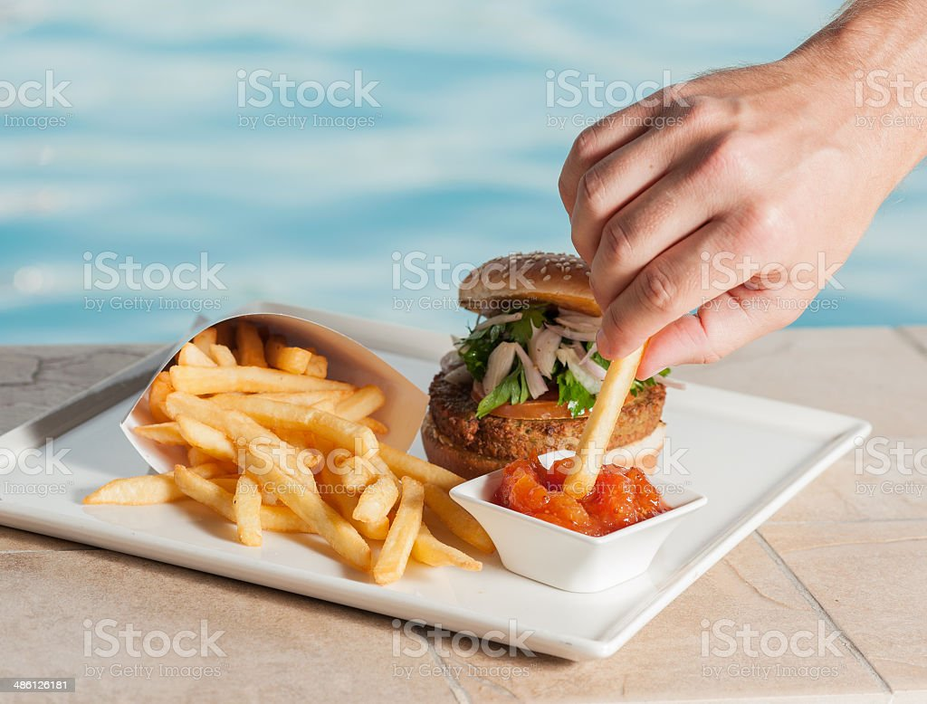 Salmon burger with hand stock photo