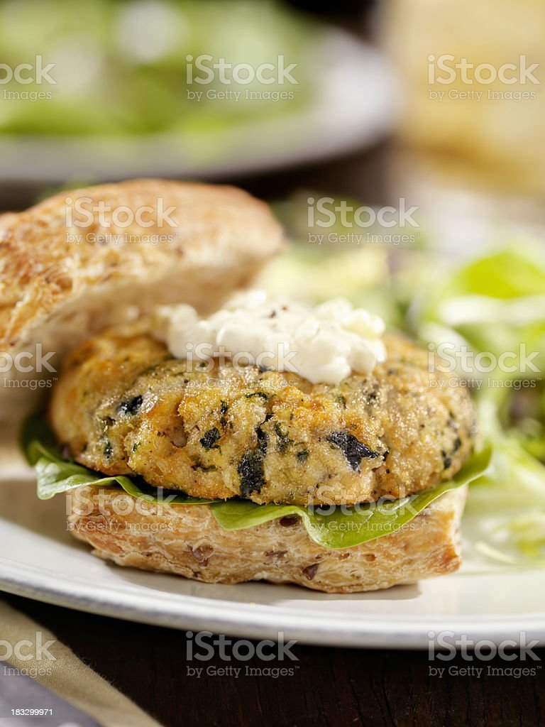 Salmon Burger with Spinach and Tarter Sauce stock photo