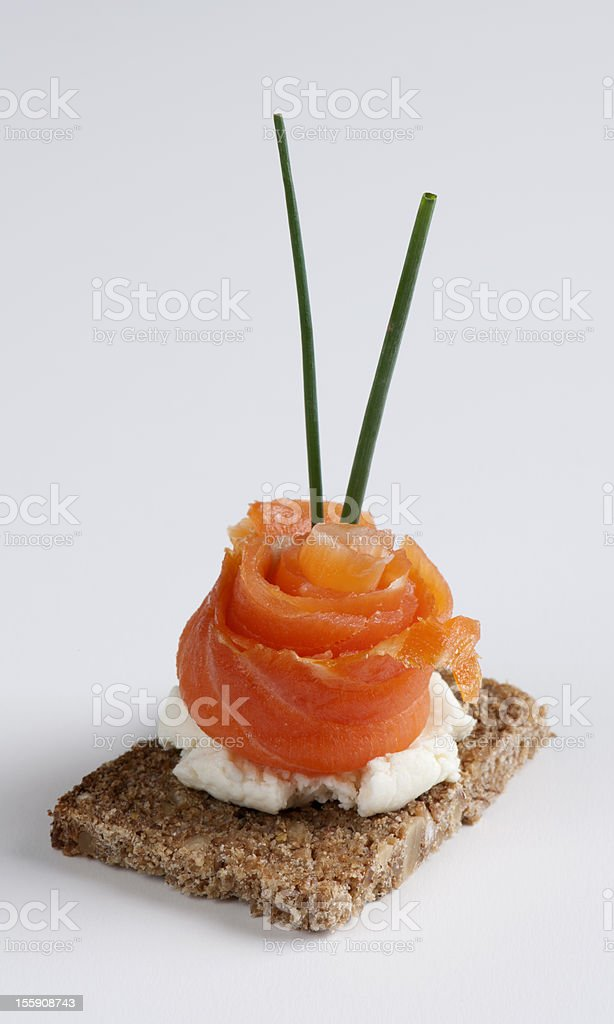Salmon canape isolated on a white background royalty-free stock photo