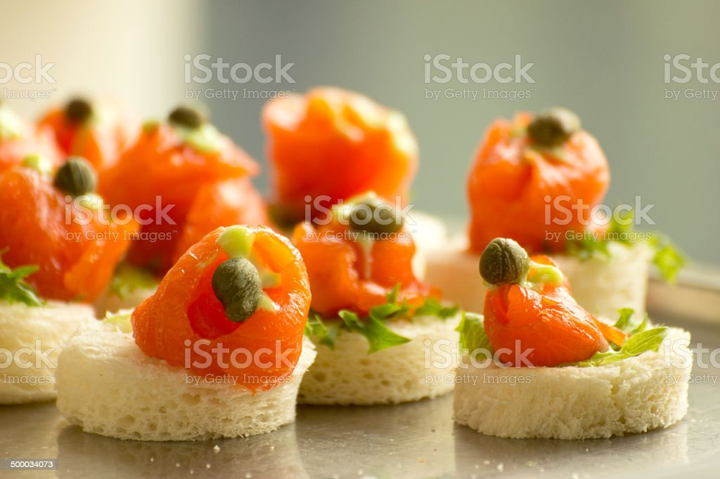 Salmon canapes at party table stock photo