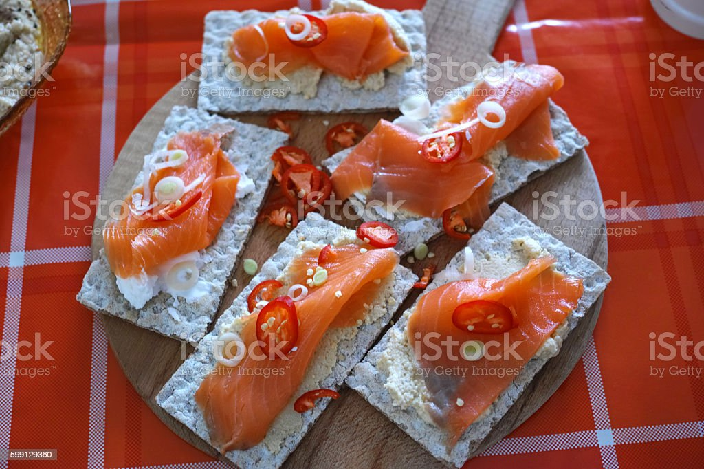 Salmon Canapes Rustic Red Background stock photo