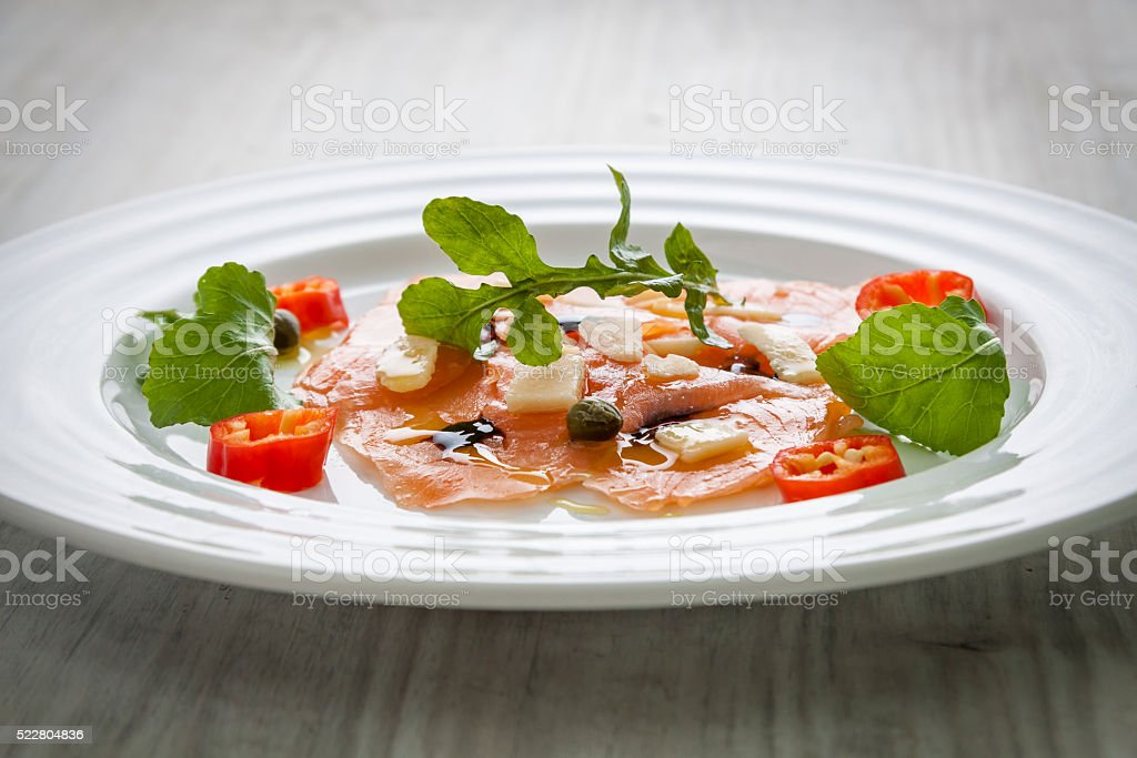 Salmon carpaccio on plate stock photo