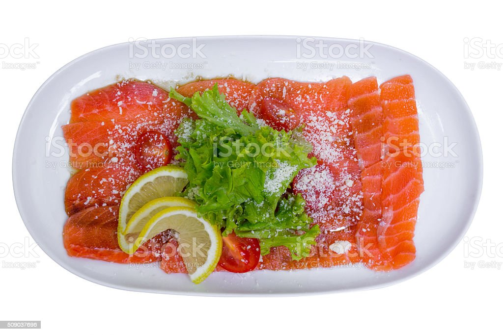 Salmon carpaccio with lemon, top view, isolated stock photo