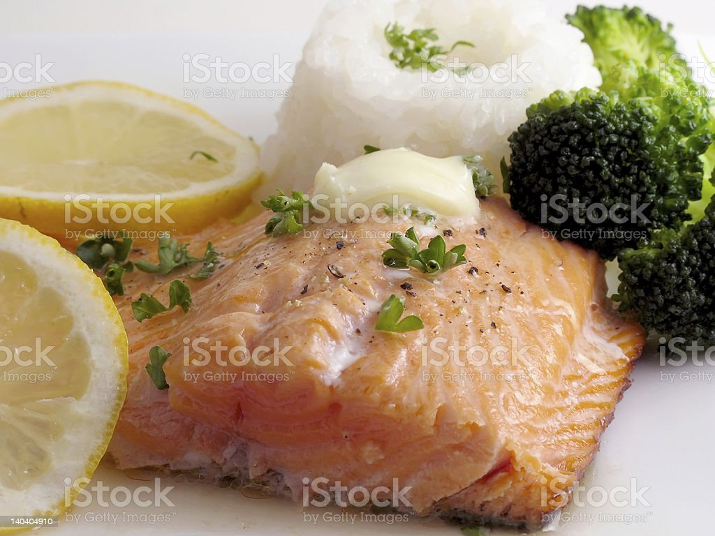 Salmon dinner with butter royalty-free stock photo