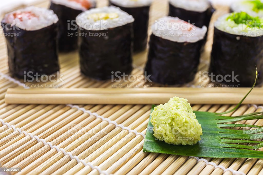 Salmon, egg and vegetable sushi rolls with sauce and wasabi stock photo