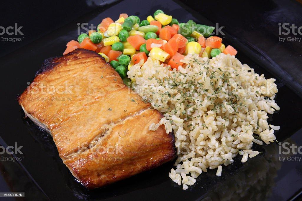 salmon filet baked dinner plate stock photo